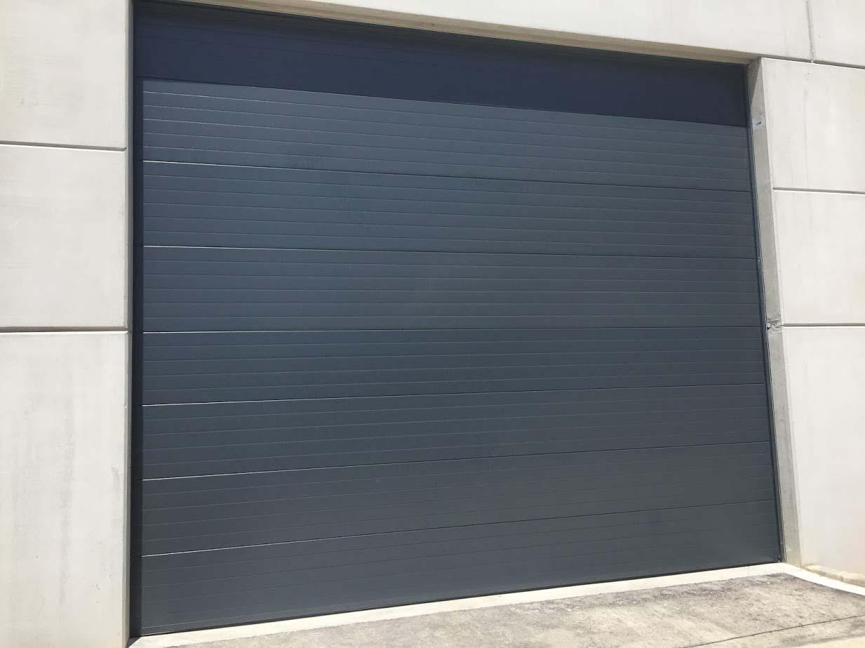 paneles puertas seccionales granollers